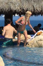 Pregnant TARA REID in Bikini at a Pool in Cabo San Lucas 06/21/2016