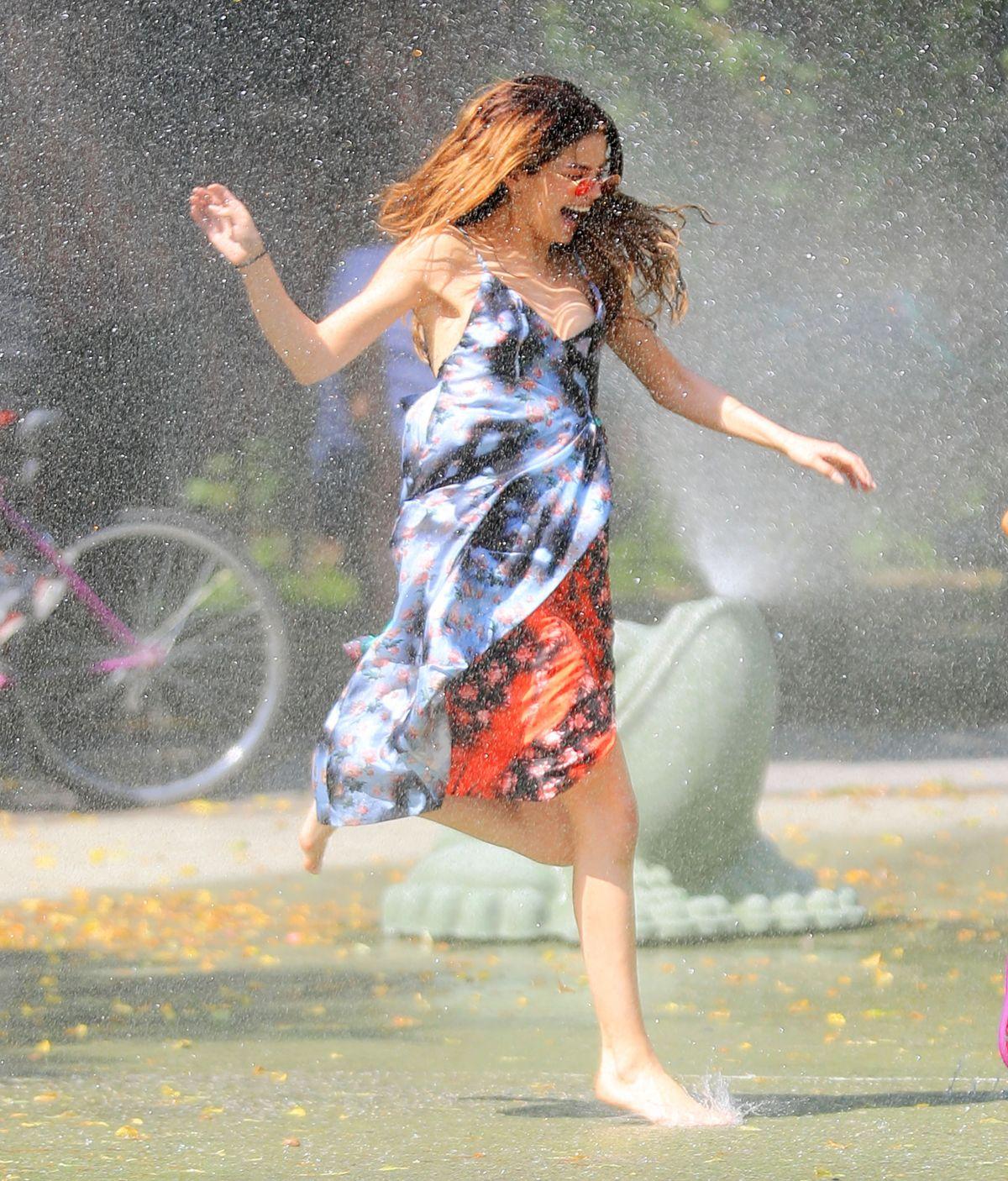 SELENA GOMEZ Running Thru Sprinklers at Water Playground in Brooklyn 06/01/2016