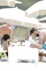 SHAKIRA in Bikini Top at a Beach in Ibiza 05/25/2016