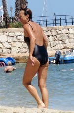 GIANNA NANNINI in Swimsuit at a Beach in Ibiza 07/17/2016