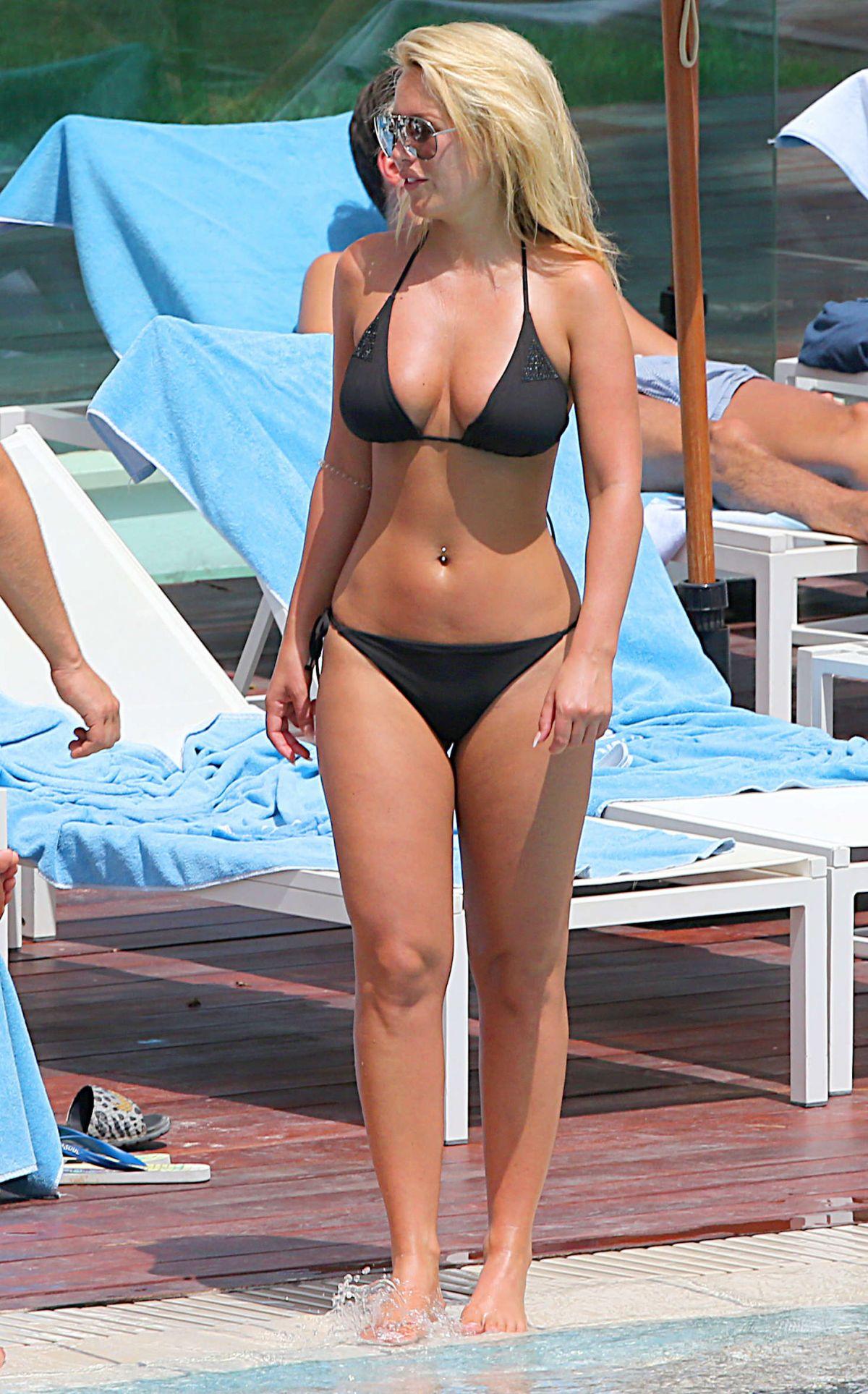 KATE WRIGHT in Bikini at a Pool in Magaluf 05/07/2016