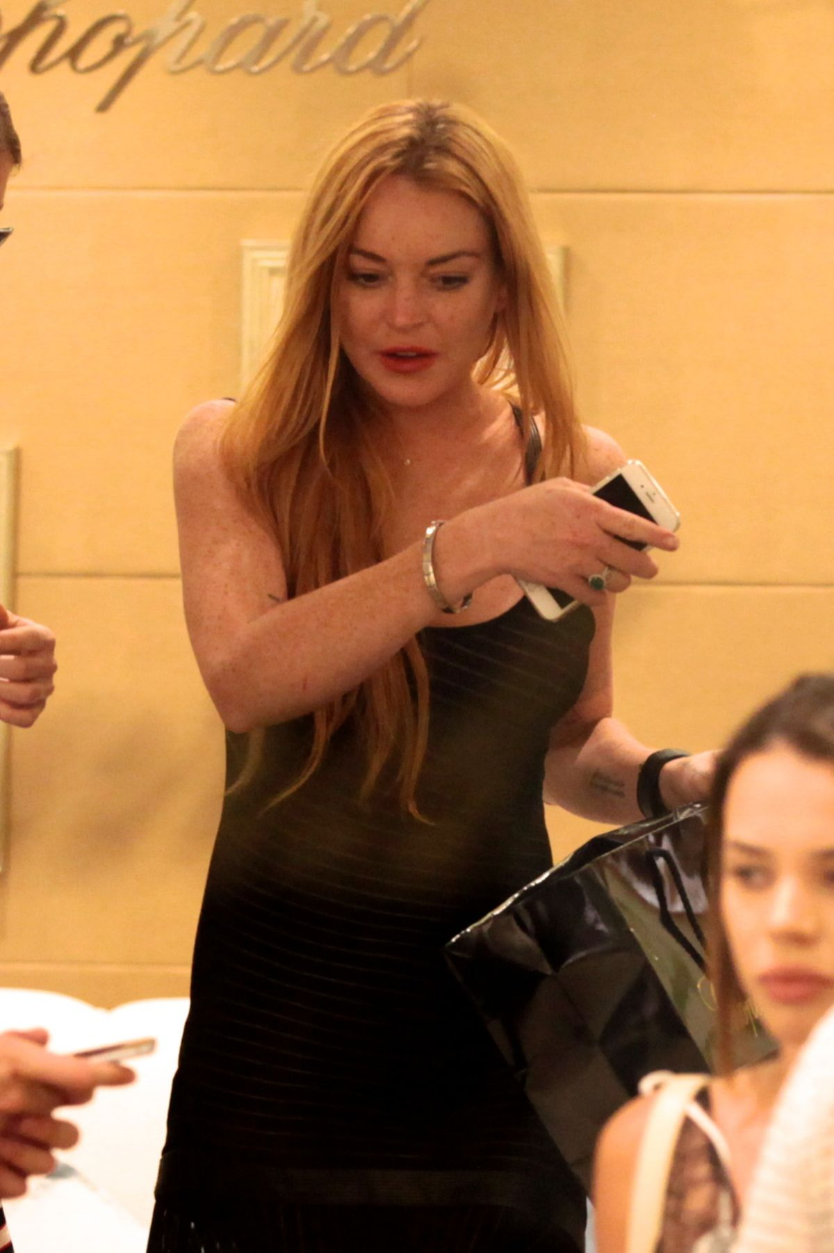 LINDSAY LOHAN Out for Dinner with Friends in Sardinia 07/29/2016