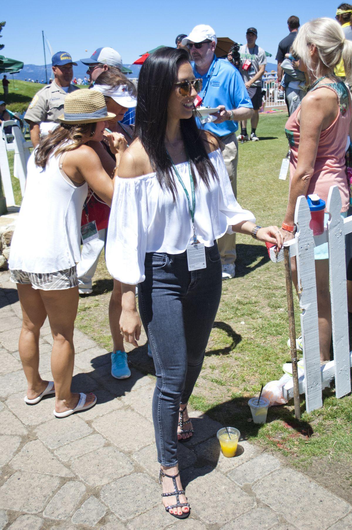 CelebPhotos: Olivia Munn - Unknown golf event Showing her