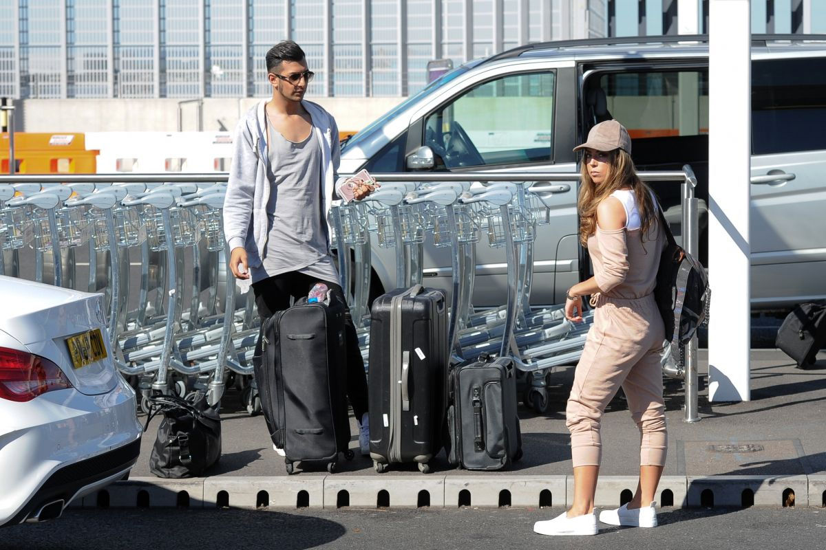 ABI CLARKE at Heathrow Airport in London 08/23/2016