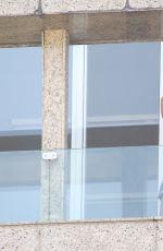 ALESSANDRA AMBROSIO Chatting on Phone on Balcony of Her Hotel in Rio de Janeiro 08/08/2016