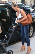 CHRISSY TEIGEN Leaves Her Hotel in New York 08/28/2016