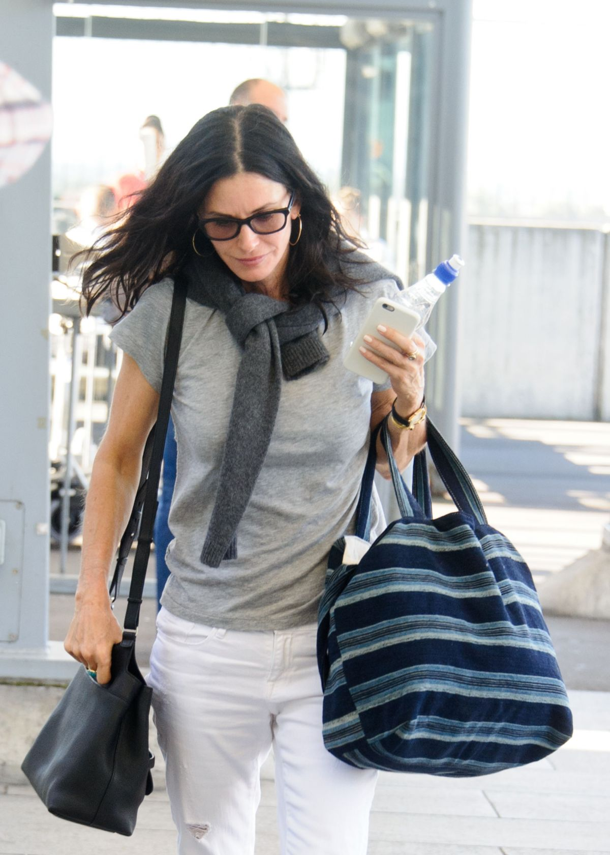 COURTENEY COX at Heathrow Airport in London 08/06/2016