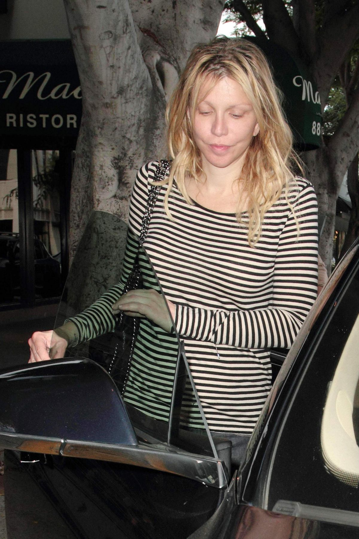 COURTNEY LOVE at Madeo Restaurant in Hollywood 08/07/2016