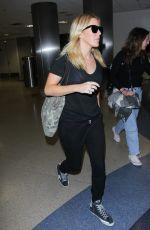ELLIE GOULDING at LAX Airport in Los Angeles 08/01/2016