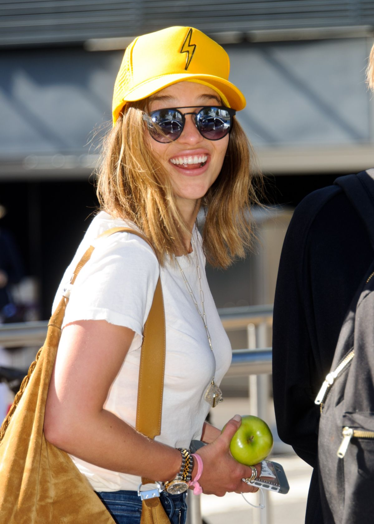 EMILIA CLARKE at Heathrow Airport in London 08/23/2016