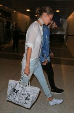 GIGI HADID at LAX Airport in Los Angeles 08/12/2016