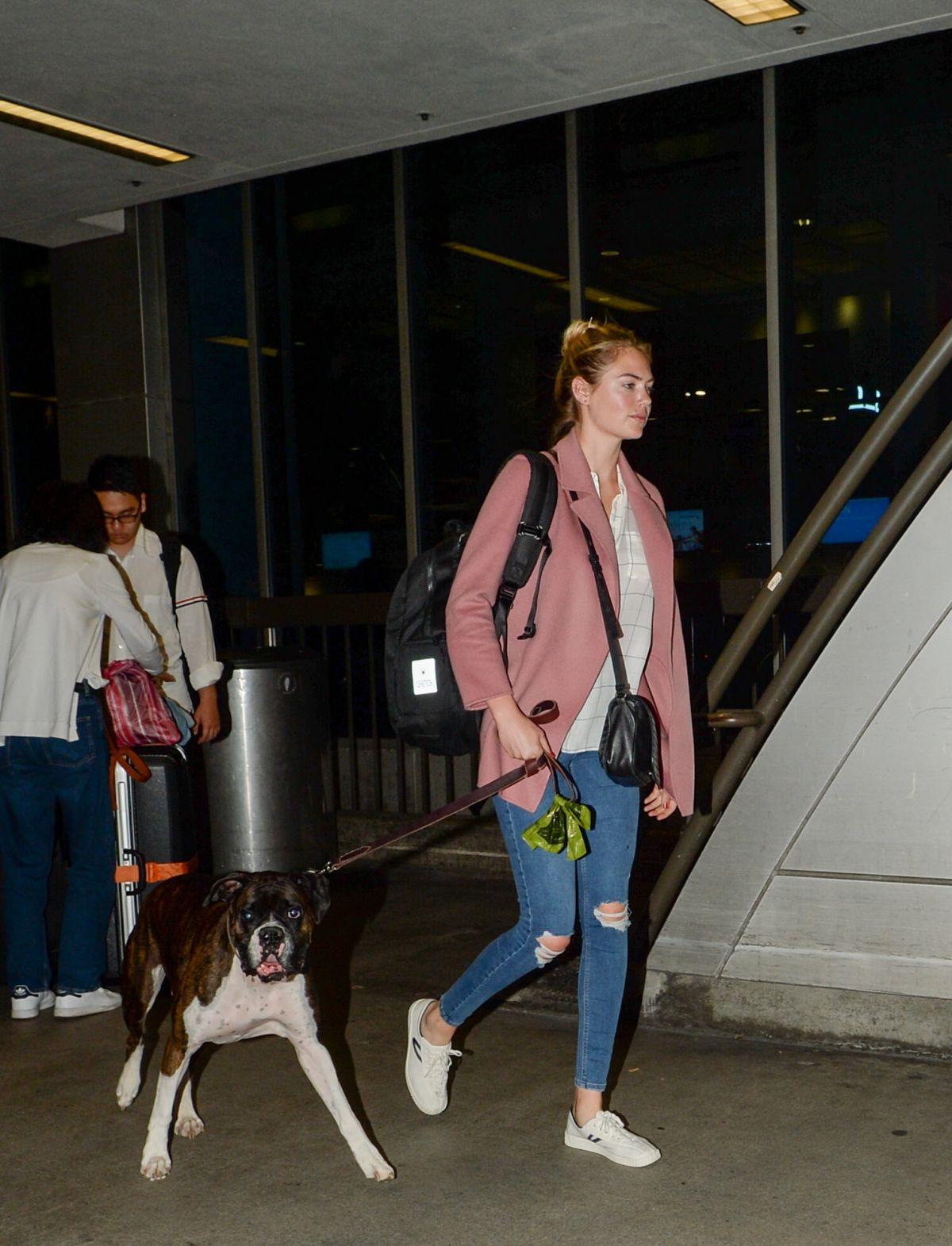 KATE UPTON with Her Dog at LAX Airport in Los Angeles 08/13/2016