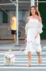 KELLY BENSIMON Walks Her Dog Out in New York 08/22/2016