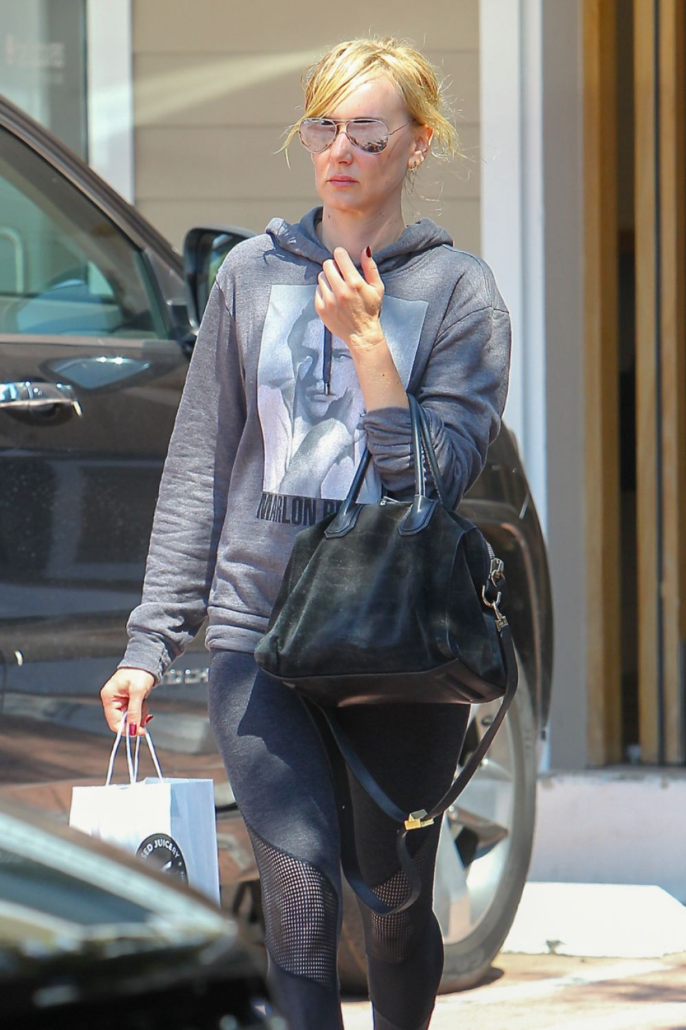 KIMBERLY STEWART Out and About in Beverly Hills 08/23/2016