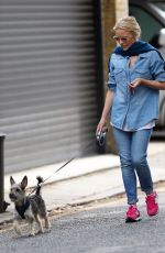 KYLIE MINOGUE Walks Her Dog Out in London 08/03/2016