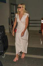 MARGOT ROBBIE at Los Angeles International Airport 08/23/2016