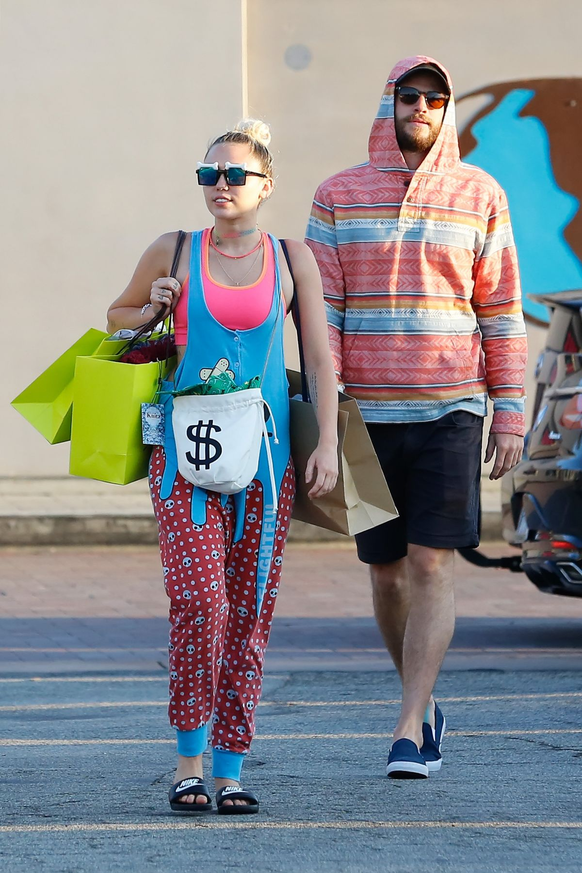 MILEY CYRUS and Liam Hemsworth Out Shopping in Los Angeles 08/21/2016