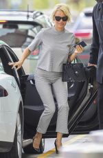 PAMELA ANDERSON Aarrives at Airport in Montreal 08/12/2016