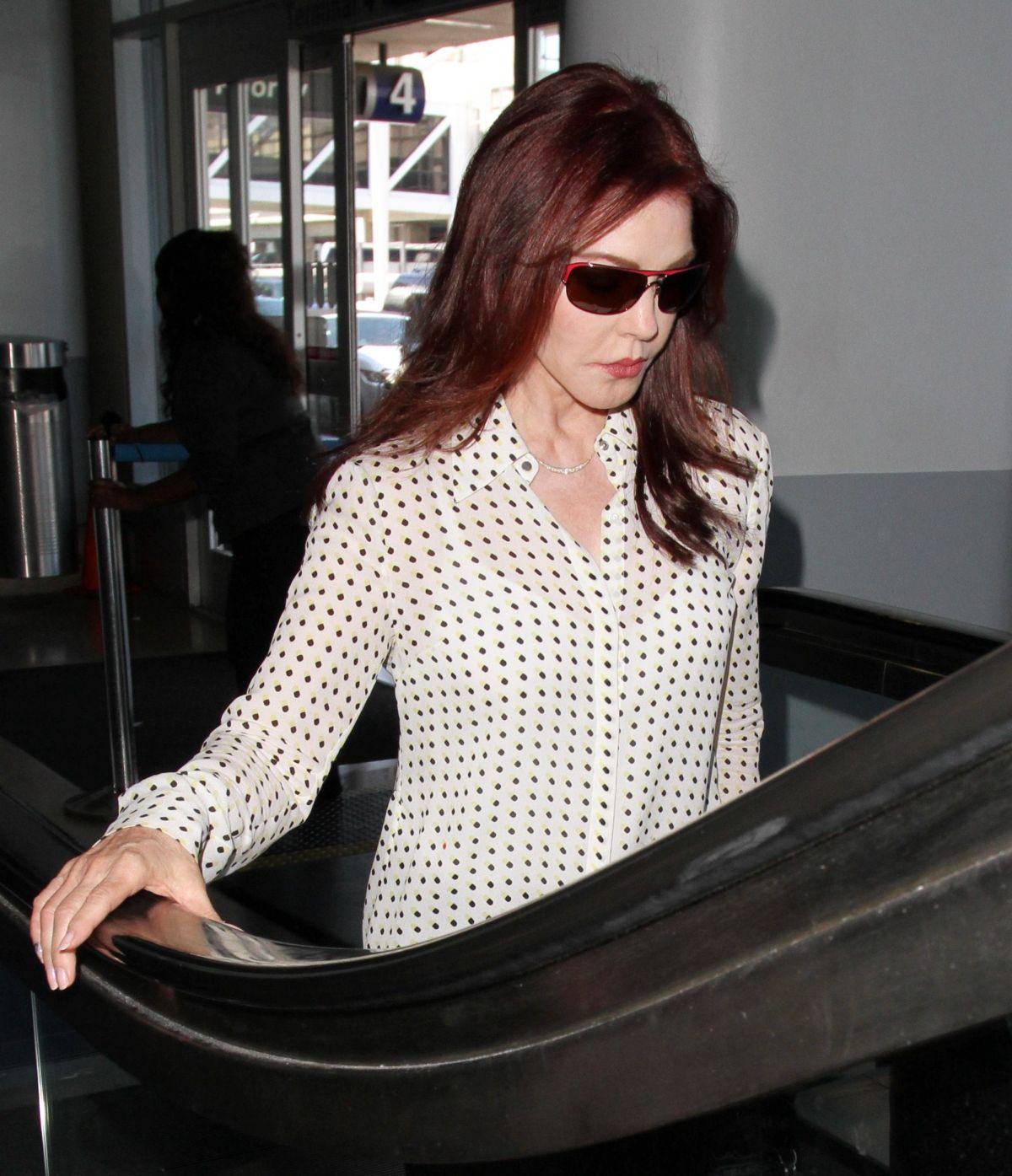 PRISCILLA PRESLEY at Los Angeles International Airport 08/19/2016