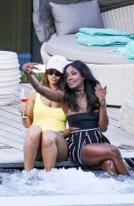 RIHANNA in Swimsuit at Pool at her Hotel in Zurich 08/13/2016