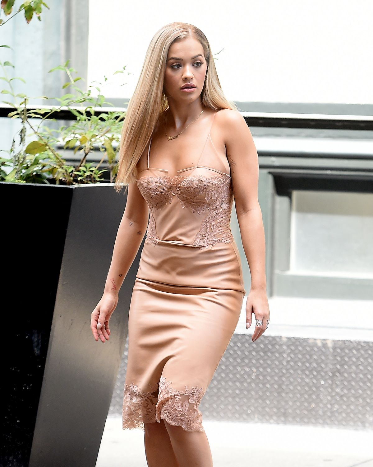 RITA ORA in a Gold Dress Out in New York 08/14/2016
