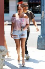 ADRIENNE BAILON in Ripped Shorts Out in Beverly Hills 08/28/2016