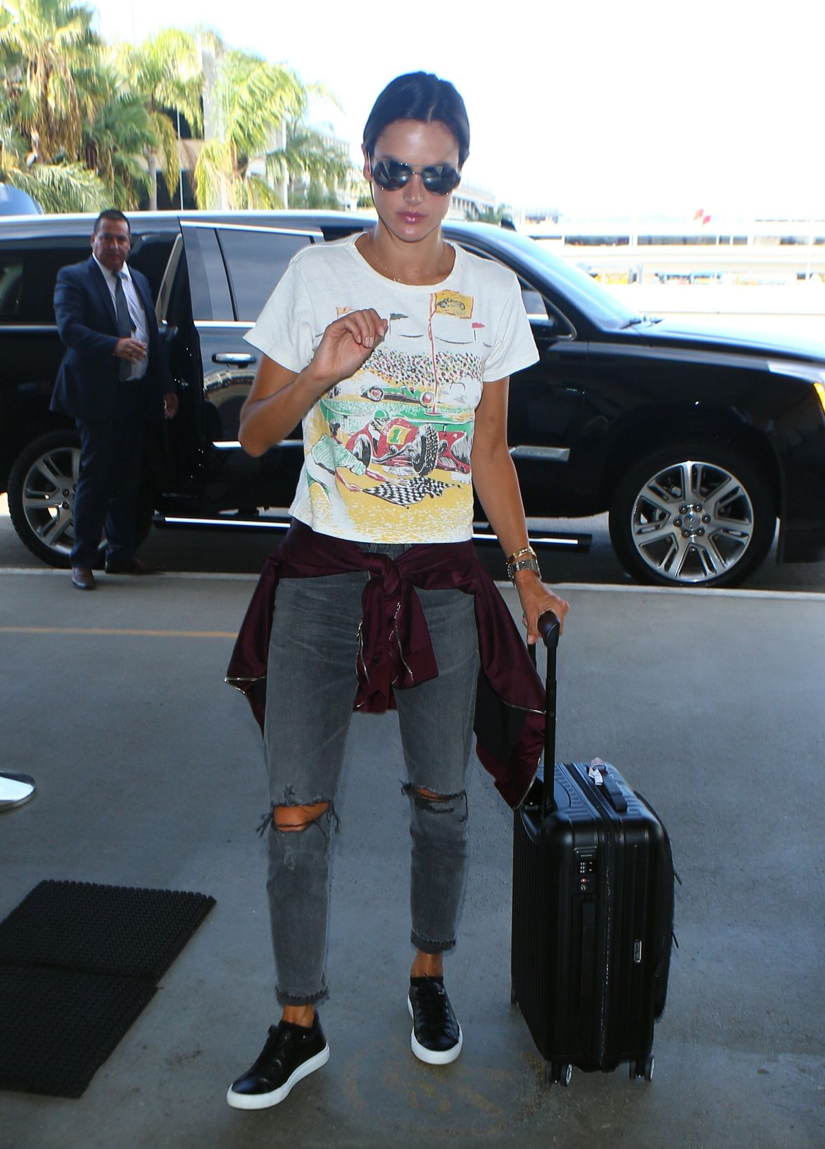 ALESSANDRA AMBROSIO Arrives at LAX Airport in Los Angeles 09/26/2016