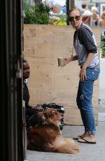 AMANDA SEYFRIED Walks Her Dog Out in New York 09/05/2016