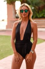 AMBER DOWDING in Swimsuit Leaves Her Hotel in Marbella 09/25/2016