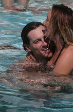 CHARLOTTE CROSBY in Bikini at a Pool in Ibiza 09/21/2016