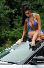CHLOE KHAN Washing Her Range Rover in a Bikini Top and Cut Off in London 09/20/2016