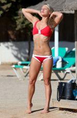 CHLOE MADELEY in Bikini at a Beach in Ibiza 09/15/2016