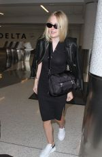 DAKOTA FANNING at Los Angeles International Airport 08/31/2016
