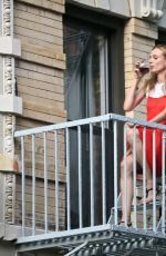 DIANE KRUGER Sipped Wine on Her Fire Escape in New York 09/06/2016