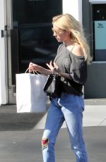 EMMA ROBERTS Leaves Fred Segal in Beverly Hills 09/21/2016