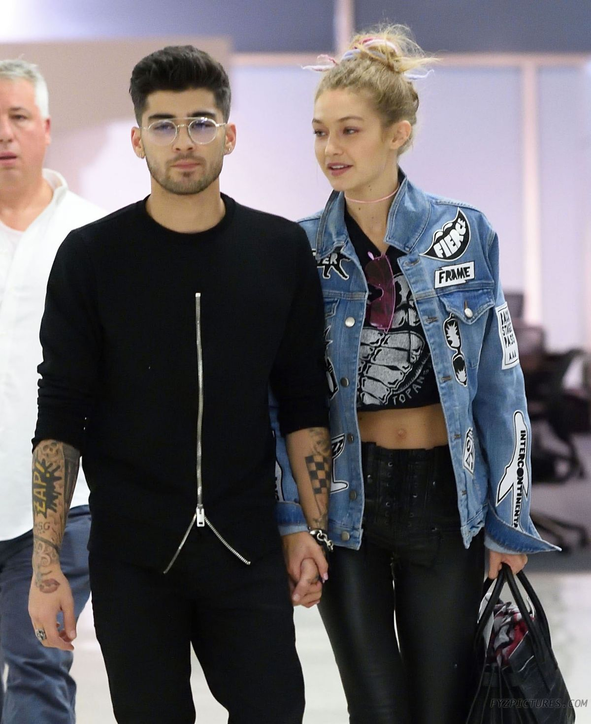 GIGI HADID and Zayn Malik at JFK Airport in New York 09/15 ...