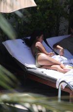 KOURTNEY KARDASHIAN in Swimsuit at a Pool in Miami 09/15/2016