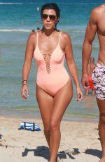 KOURTNEY KARDASHIAN in Swimsuit oat a Beach in Miami 09/17/2016