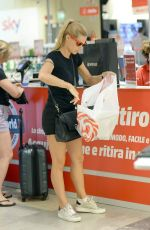 MICHELLE HUNZIKER Shopping at Media World in Milan 09/04/2016