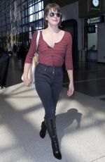 MILLA JOVOVICH at Los Angeles International Airport 09/28/2016