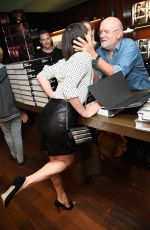 MILLA JOVOVICH at Peter Lindbergh Book Signing in Los Angeles 09/20/2016