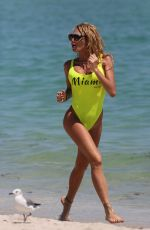 VICKY XIPOLITAKIS in Yellow Swimsuit at a Beach in Miami 09/21/2016