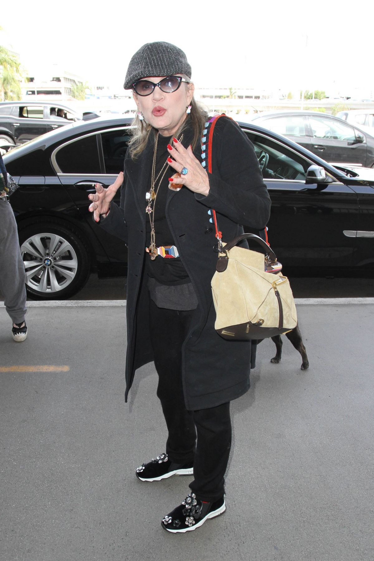 CARRIE FISHER at LAX Airport in Los Angeles 10/07/2016