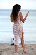 CLAUDIA ROMANI in Bikini at a Beach in Miami 10/08/2016