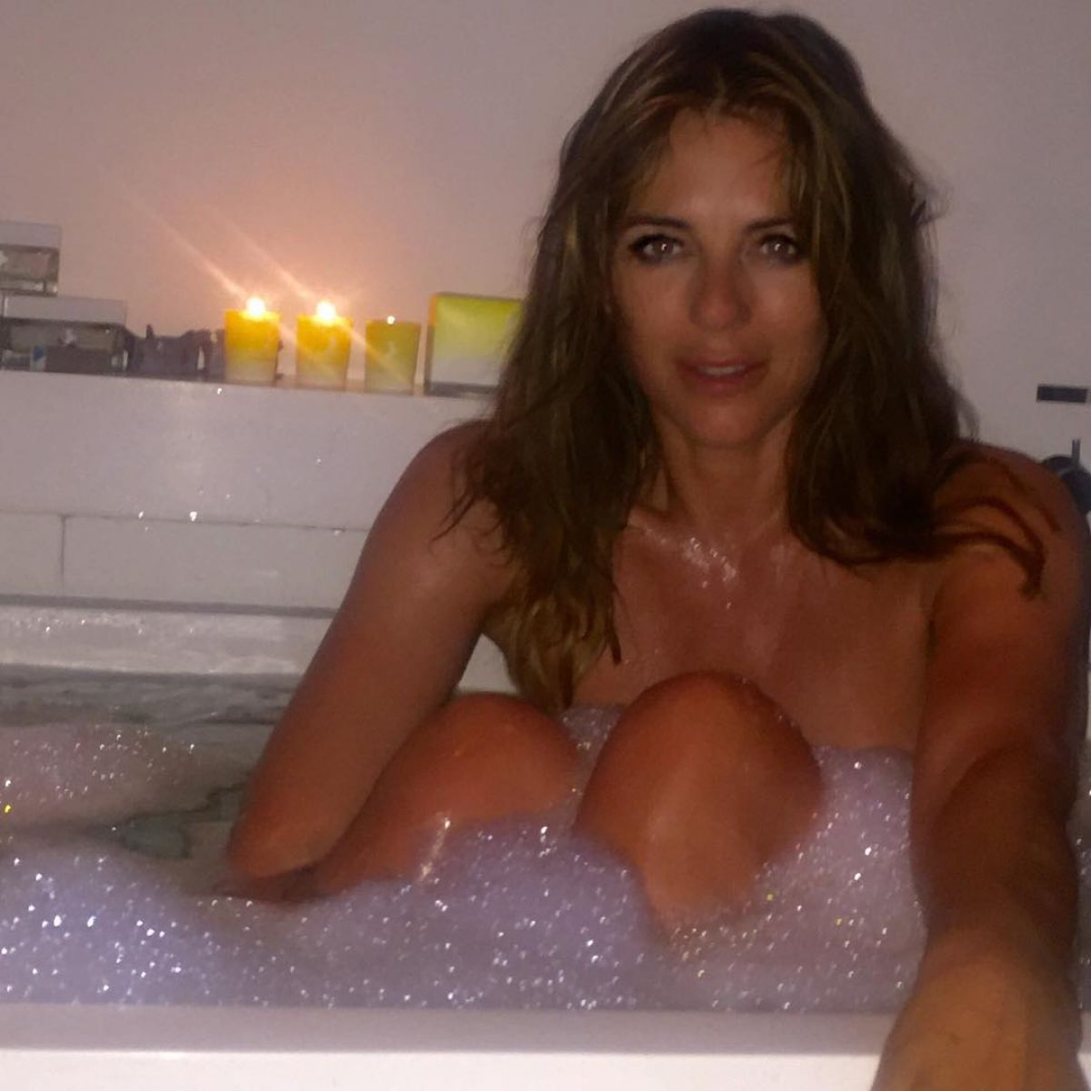 Elizabeth Hurley, 50, Sunbathes Topless: See the Sexy