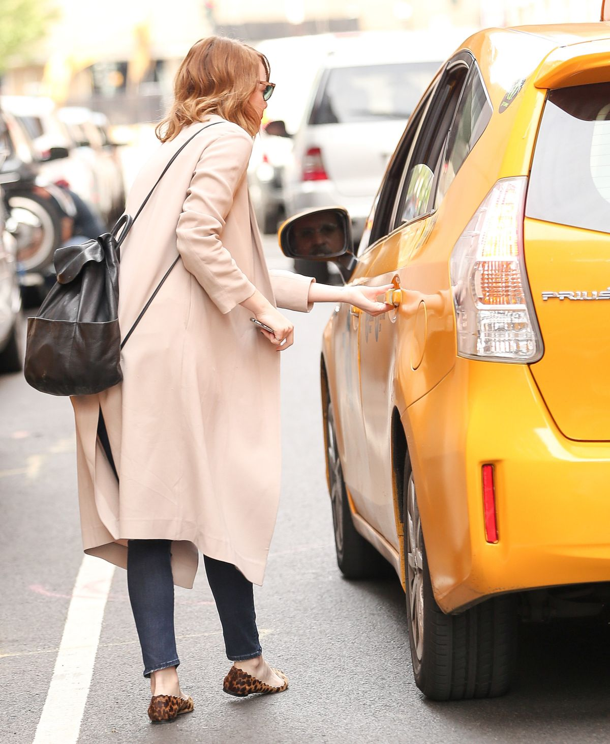 EMMA STONE Gets a Cab in New York 09/29/2016