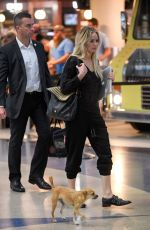 JENNIFER LAWRENCE with Her Dog at JFK Airport in New York 10/29/2016