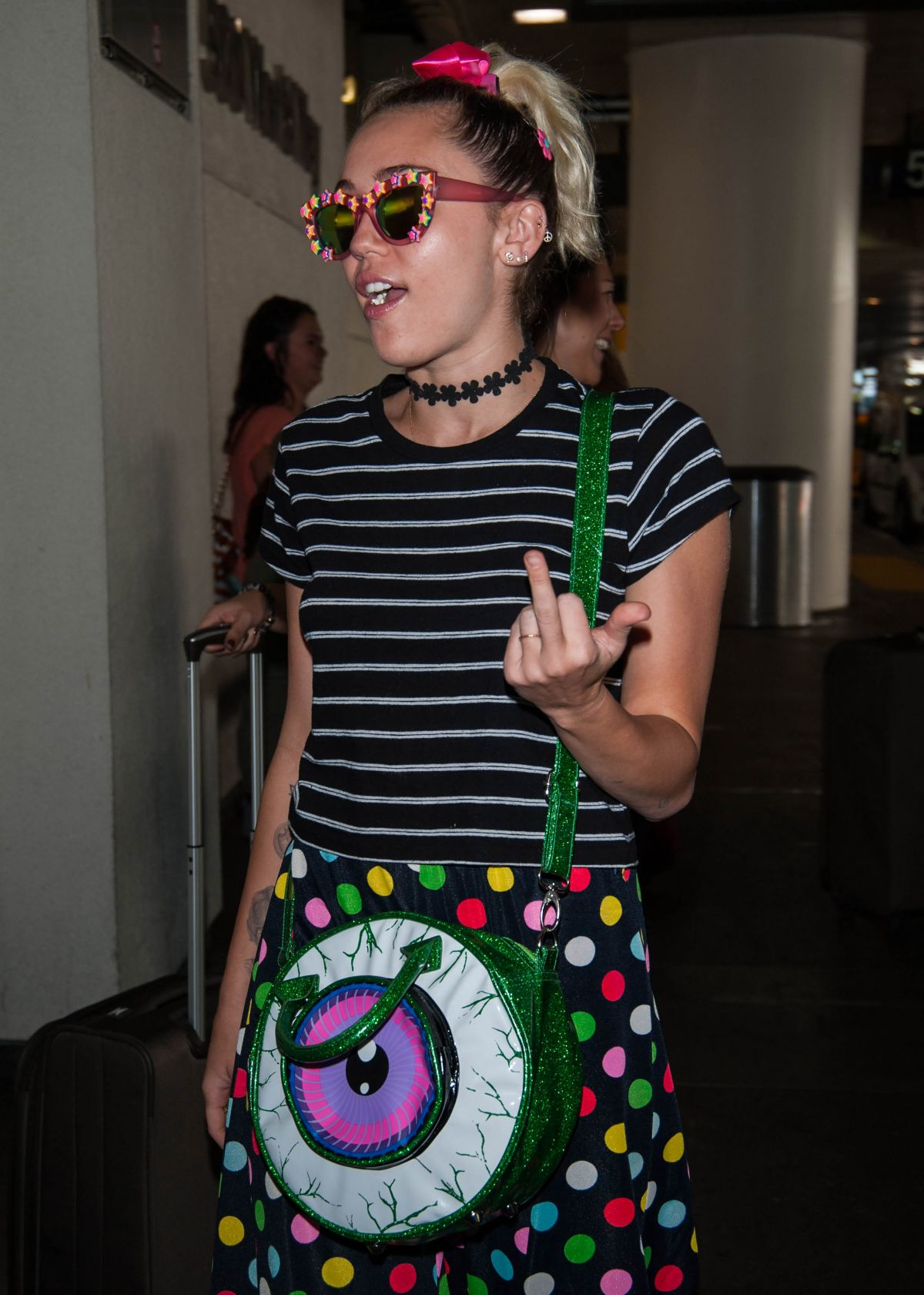 MILEY CYRUS at LAX Airport in Los Angeles 09/30/2016