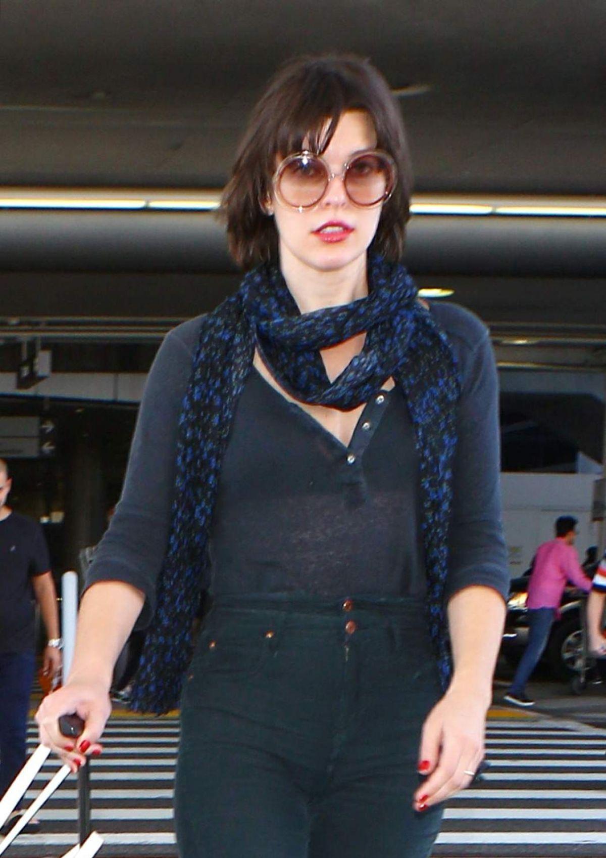 MILLA JOVOVICH at Los Angeles international Airport 10/02 ... Milla Jovovich