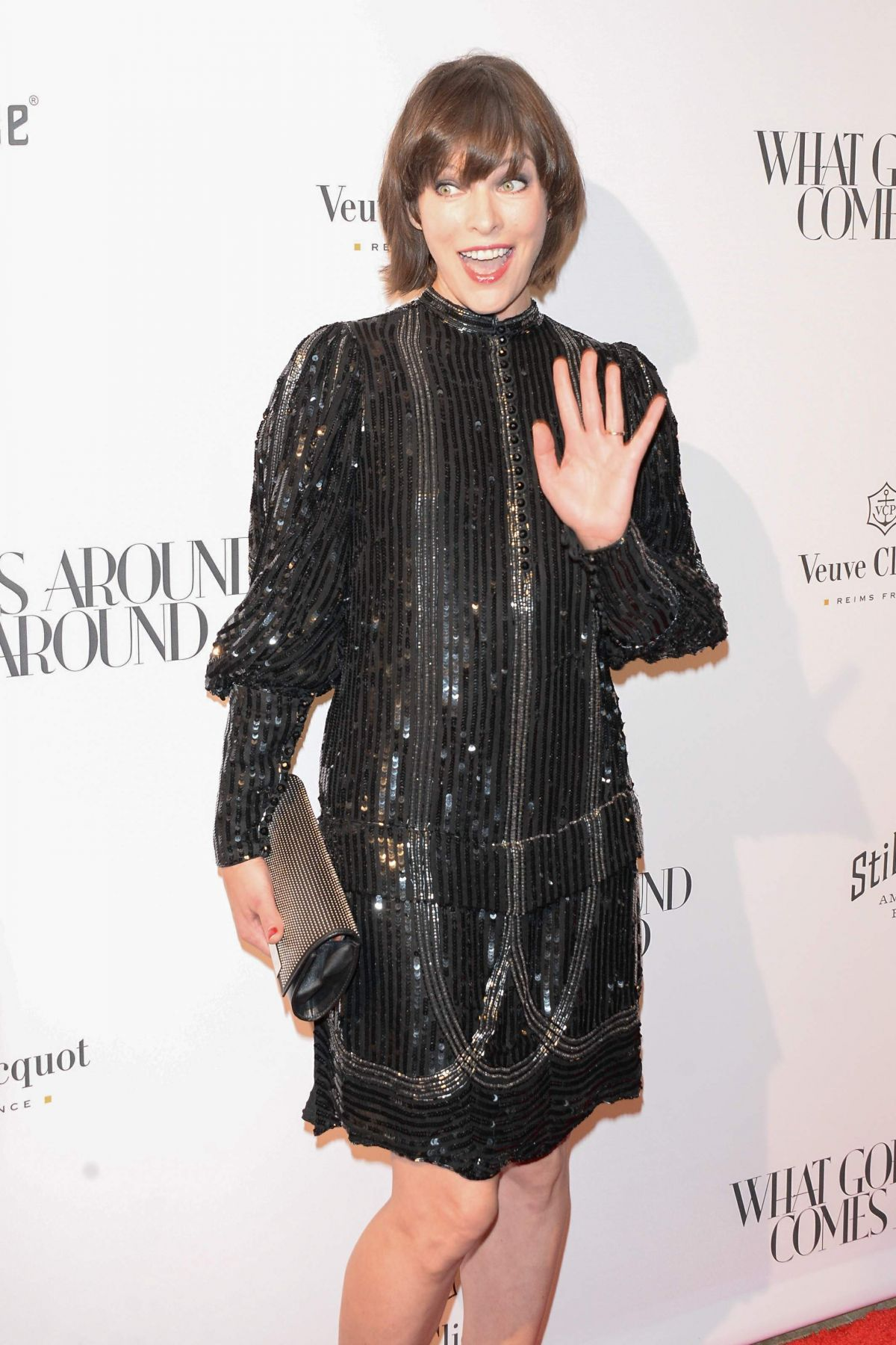 MILLA JOVOVICH at What Goes Around Comes Around Beverly Hills Opening ...